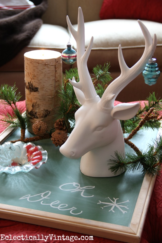 An old chalkboard becomes a tray for a Christmas display - love the ceramic stag head kellyelko.com