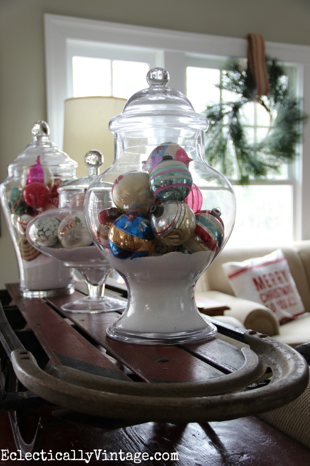 Christmas Shiny Brites on display in a collection of apothecary jars kellyelko.com