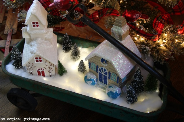 Make a DIY fairy light glowing snow village - so cute in this vintage wagon kellyelko.com