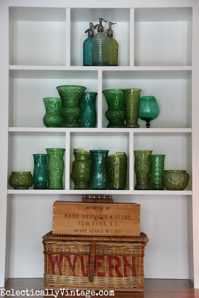 "Unique Christmas Tree - a bunch of vintage green glass in a bookcase - love the ""trunk"" too! kellyelko.com"