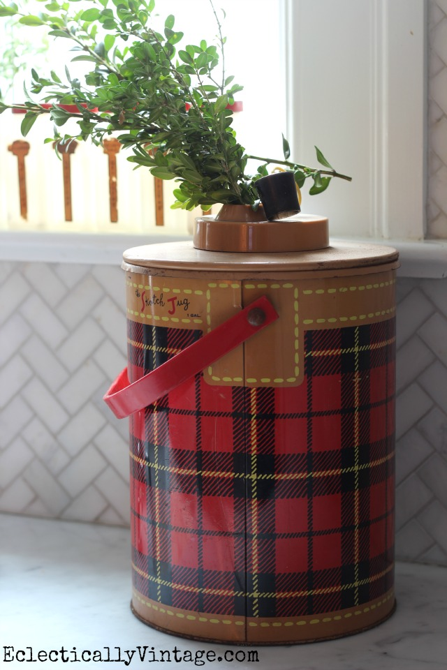 Vintage Skotch Jug is a cute Christmas decoration with a few sprigs of boxwood kellyelko.com