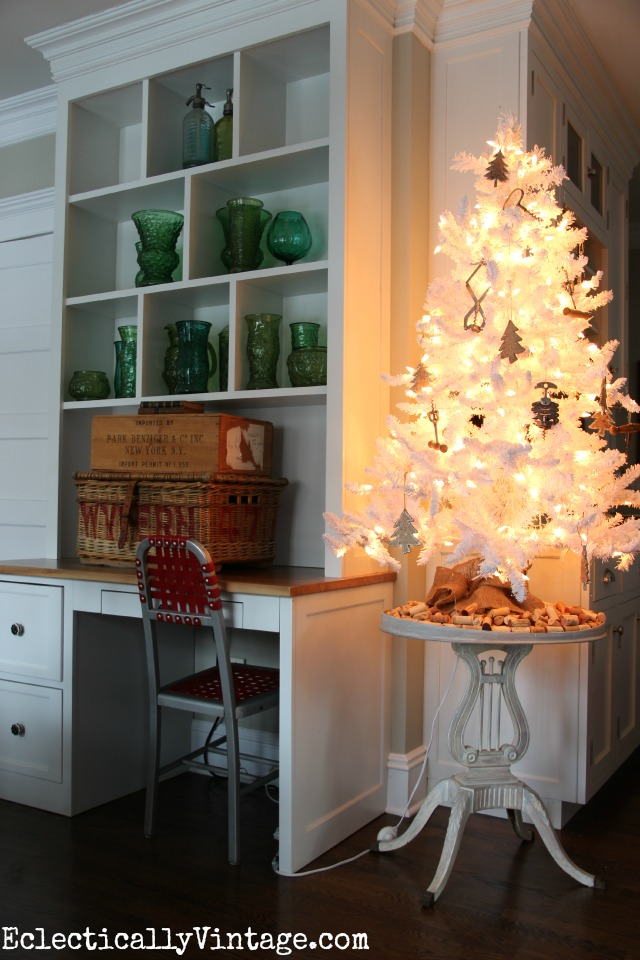 Festive Christmas kitchen - love the white flocked Christmas tree with the corkscrew ornaments kellyelko.com