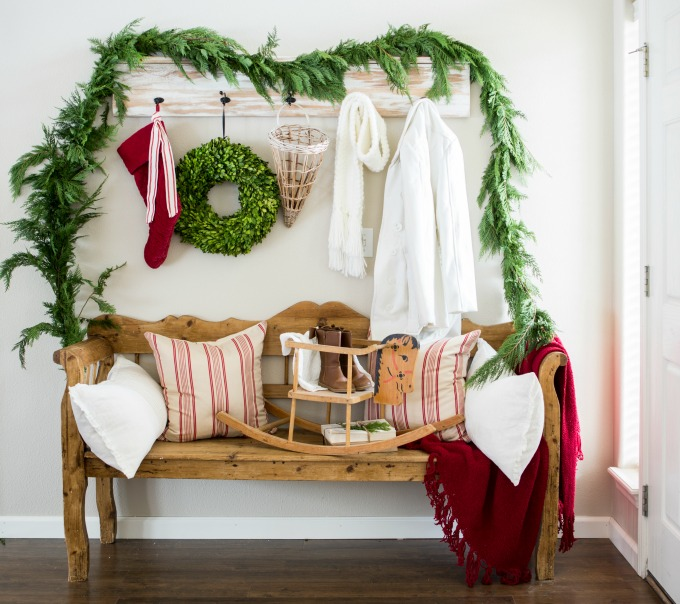 Festive Christmas entryway - love the fresh garland eclectiallyvintage.com