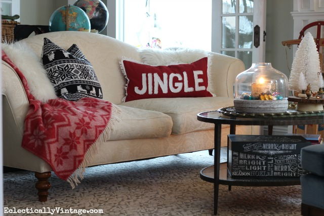 Cozy Christmas decorating - love the fun pillows and throw kellyelko.com