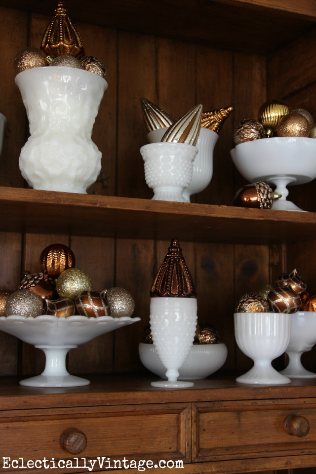 Vintage milk glass collection - fun way to display Christmas ornaments kellyelko.com