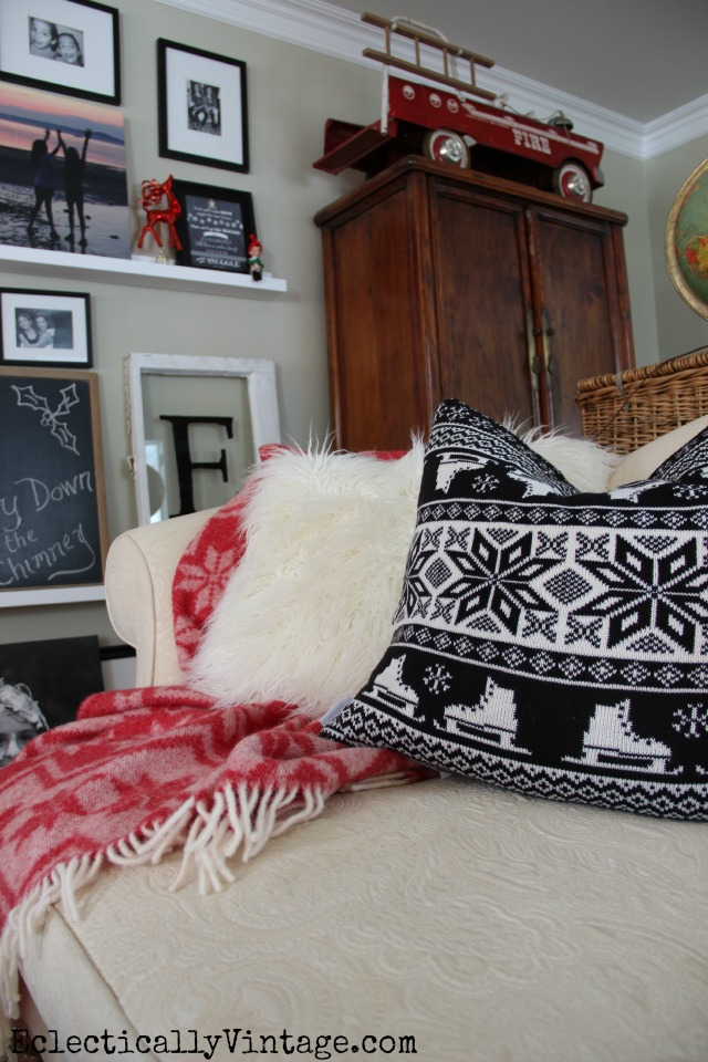 Cozy Christmas living room - love the black and white pillow and that adorable fire truck! kellyelko.com