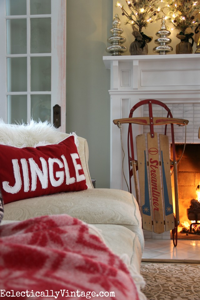Vintage sled is fun to bring inside for Christmas decorating - love the Jingle pillow too! kellyelko.com