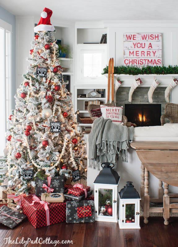 Cozy Christmas house - love the flocked tree kellyelko.com