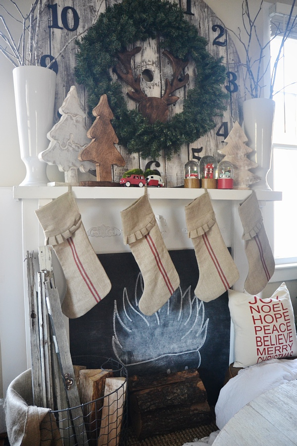 Festive mantel - love the pallet clock and the grain sack stockings kellyelko.com