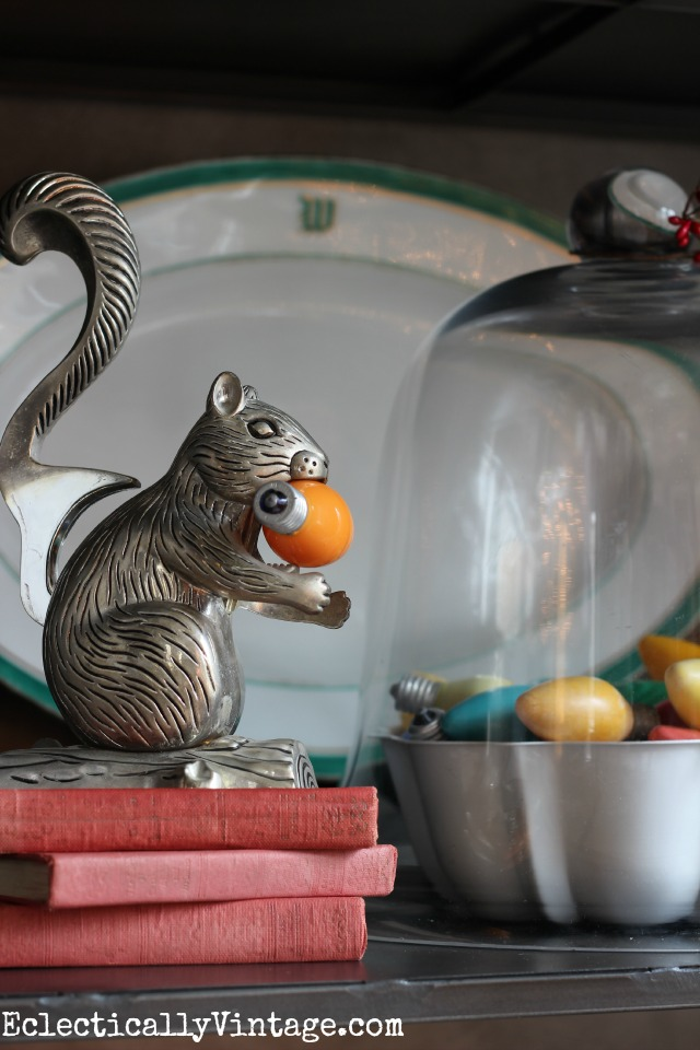 Vintage squirrel nutcracker takes a bite out of old Christmas bulb! kellyelko.com
