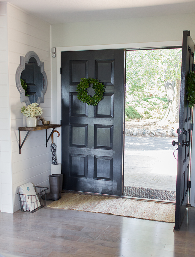 Stunning entryway - love the black front door and the planked wall kellyelko.com