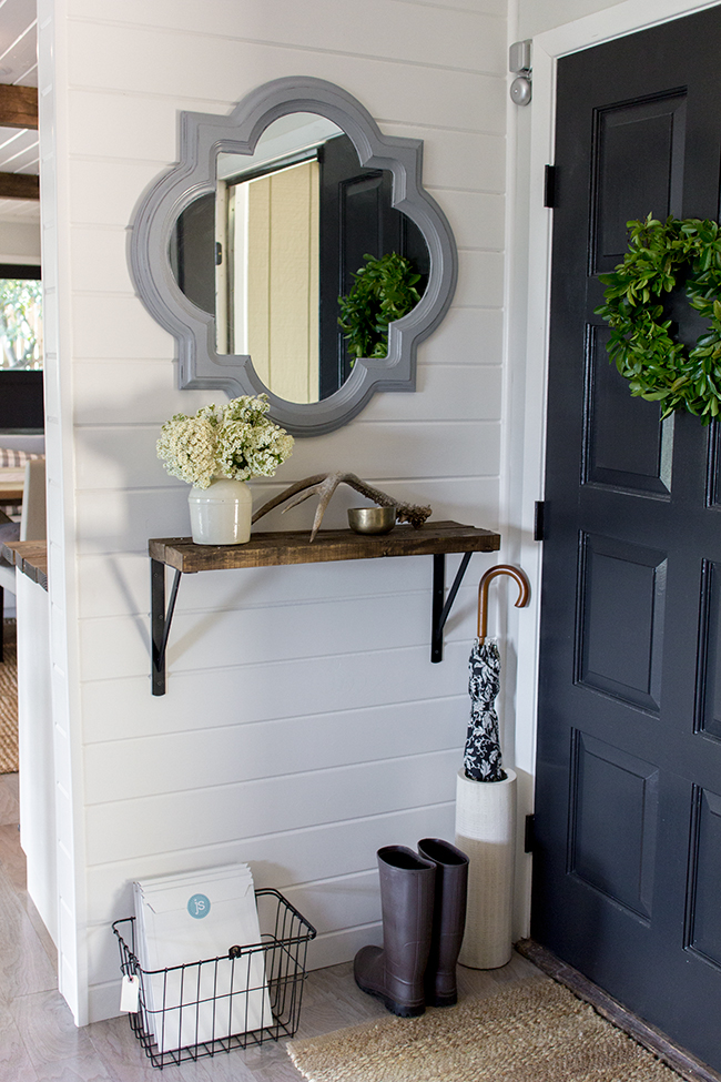Gorgeous small entry decor ideas - love the mirror and wall shelf kellyelko.com