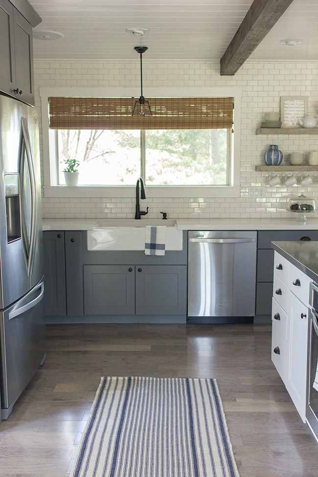 This kitchen is a stunner - from the floor to ceiling subway tile to the plank ceiling to the gray cabinets ... kellyelko.com