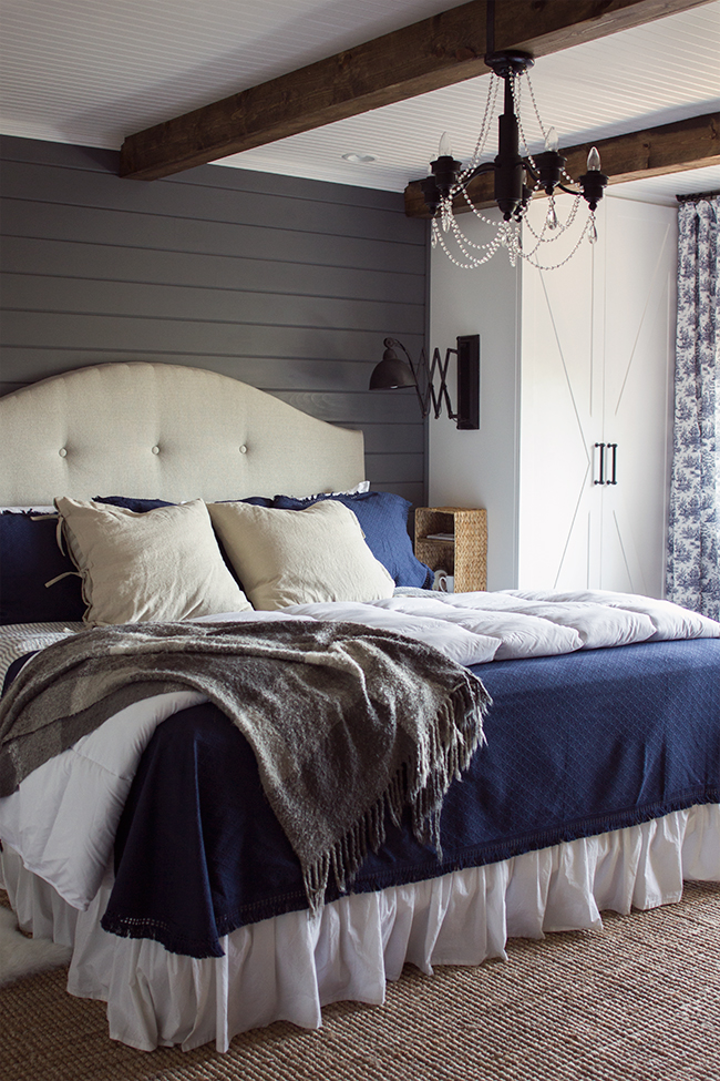 Cozy master bedroom - love the gray planked walls, beams on the ceiling, built in cabinets instead of bed side tables and more kellyelko.com