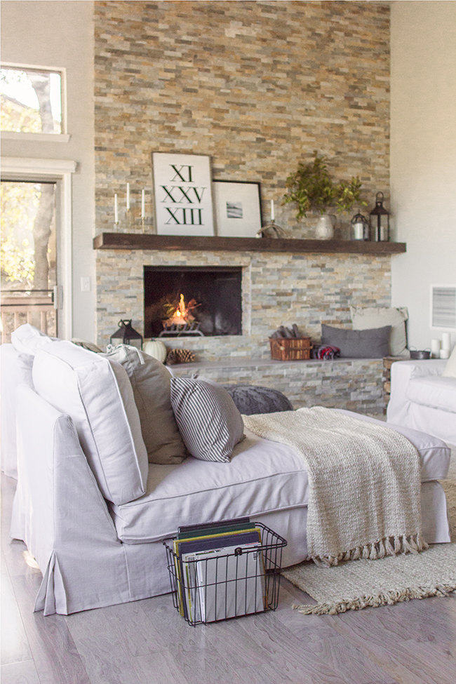 Stunning floor to ceiling tile fireplace wall - this home is gorgeous! kellyelko.com