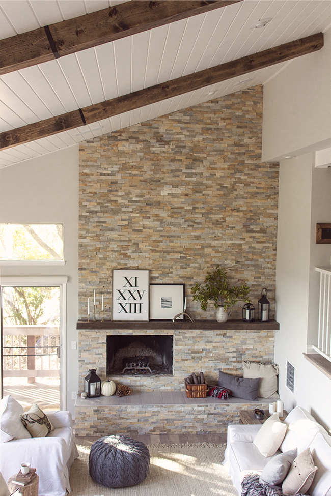 Gorgeous home tour featuring tons of DIY ideas on a budget - love the floor to ceiling tile fireplace and the plank ceiling kellyelko.com