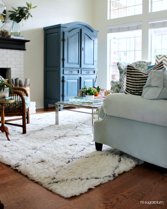 Gorgeous living room with fun color and pattern and love the blue armoire kellyelko.com