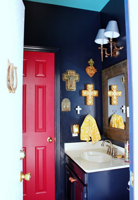 Bold black bathroom walls with red door - love the collection of 21 crosses kellyelko.com