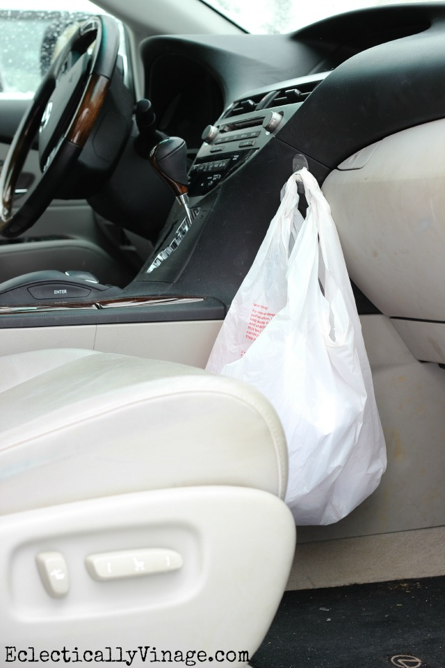 Great idea - hang a trash bag from a hook in the car! kellyelko.com #DamageFreeDIY