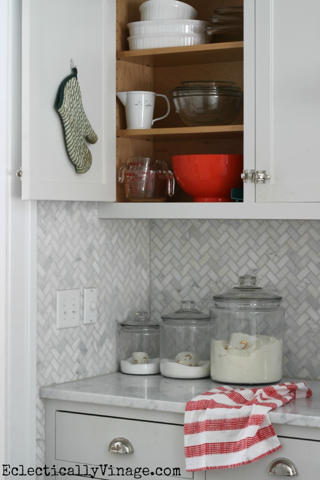 Love the idea of hanging things inside the kitchen cabinets kellyelko.com #DamageFreeDIY