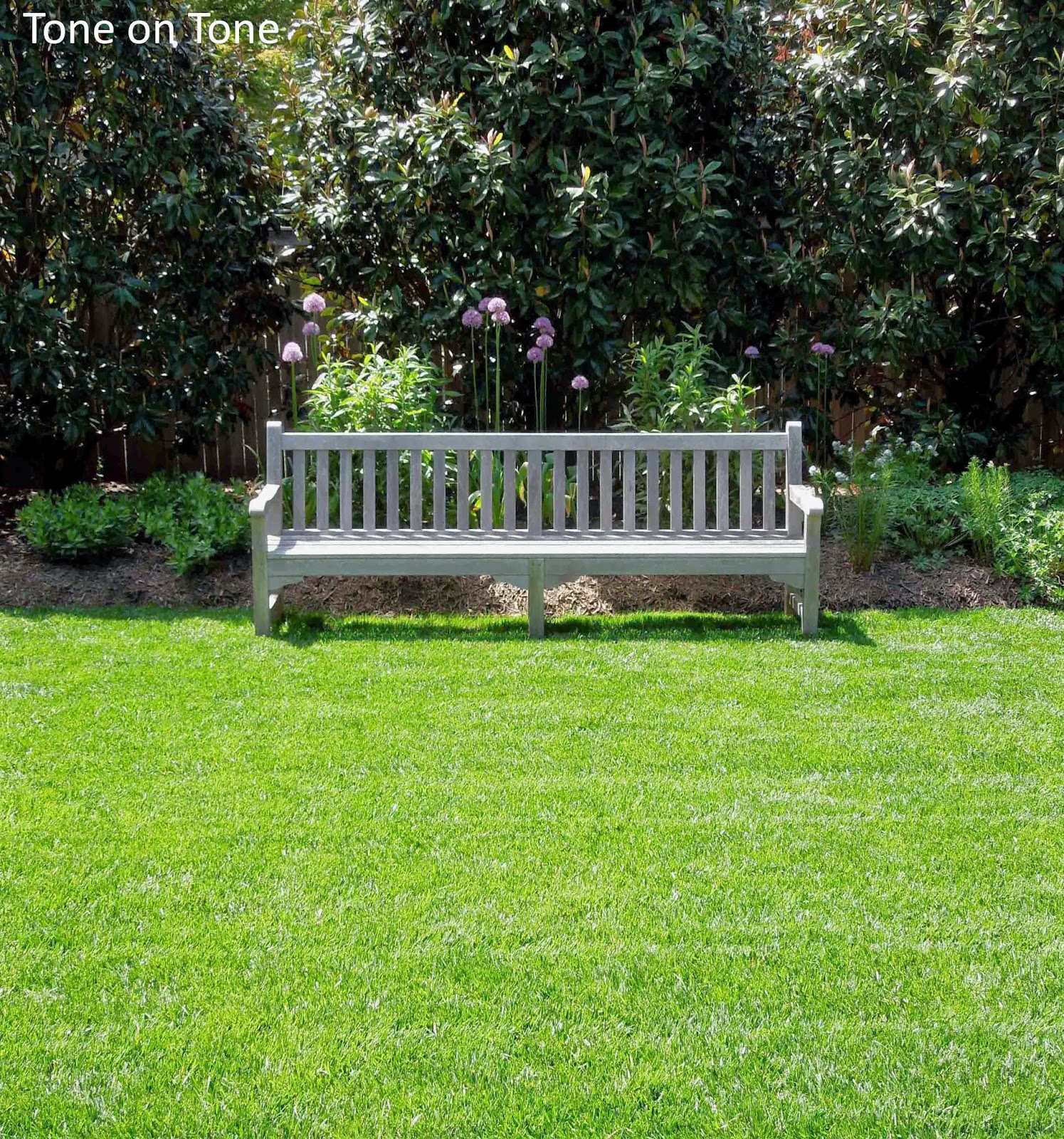 Create a focal point in your landscaping with a bench