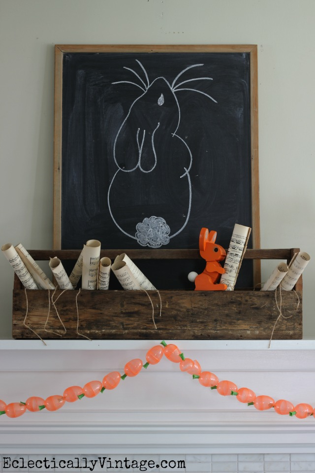 I love this spring mantel - the toolbox filled with music sheets and the adorable DIY carrot garland! kellyelko.com