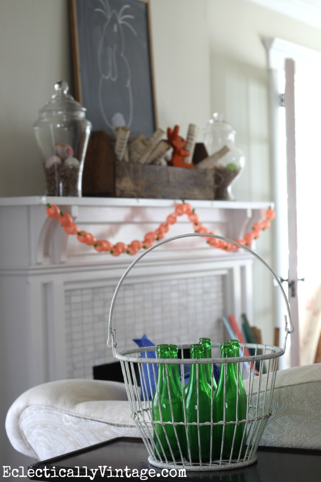 This Easter bunny mantel is so fabulous! Love the old toolbox filled with rolled music sheets kellyelko.com