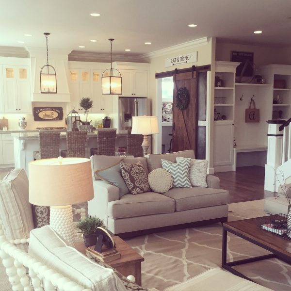 Open floor plan kitchen and family room in neutrals - love the farmhouse style kellyelko.com