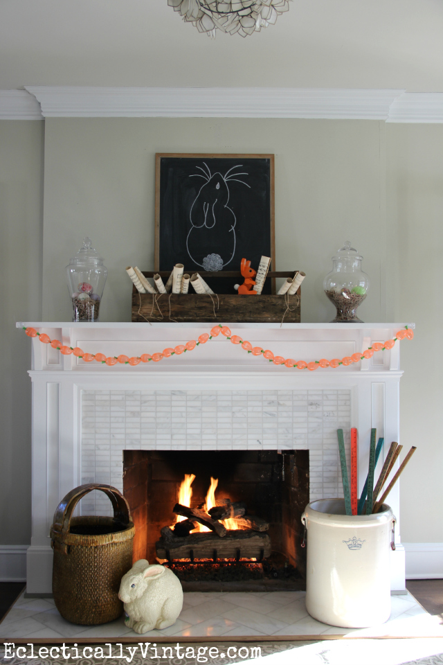 Love this fun spring mantel - see how she used the exact same pieces from winter with just a few minor changes kellyelko.com