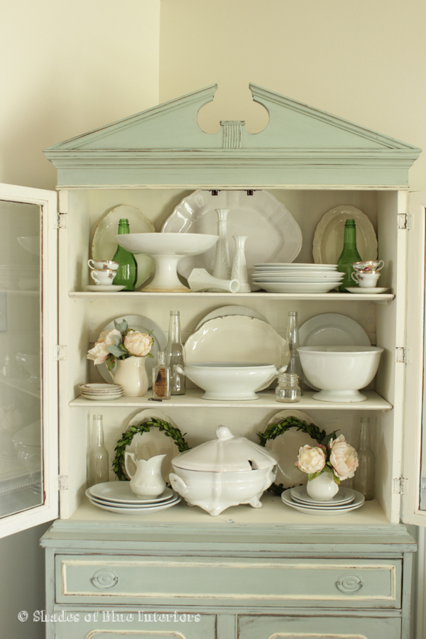 Corner hutch filled with beautiful collections - love the iron stone kellyelko.com