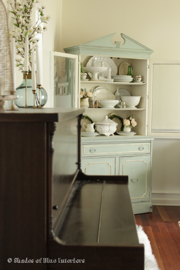 Corner hutch filled with iron stone and vintage collections kellyelko.com