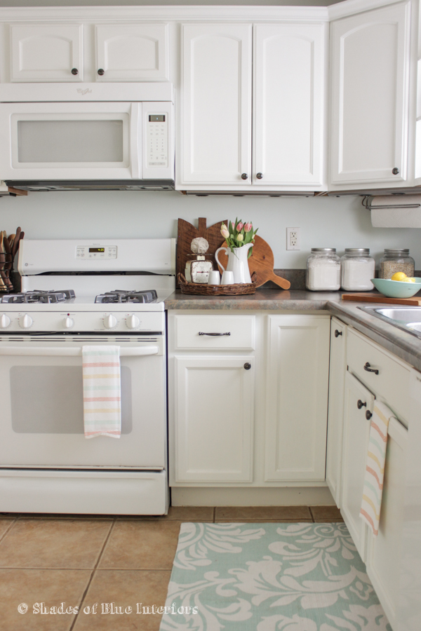 Give your dated kitchen cabinets a fresh coat of white paint for an instant kitchen update kellyelko.com