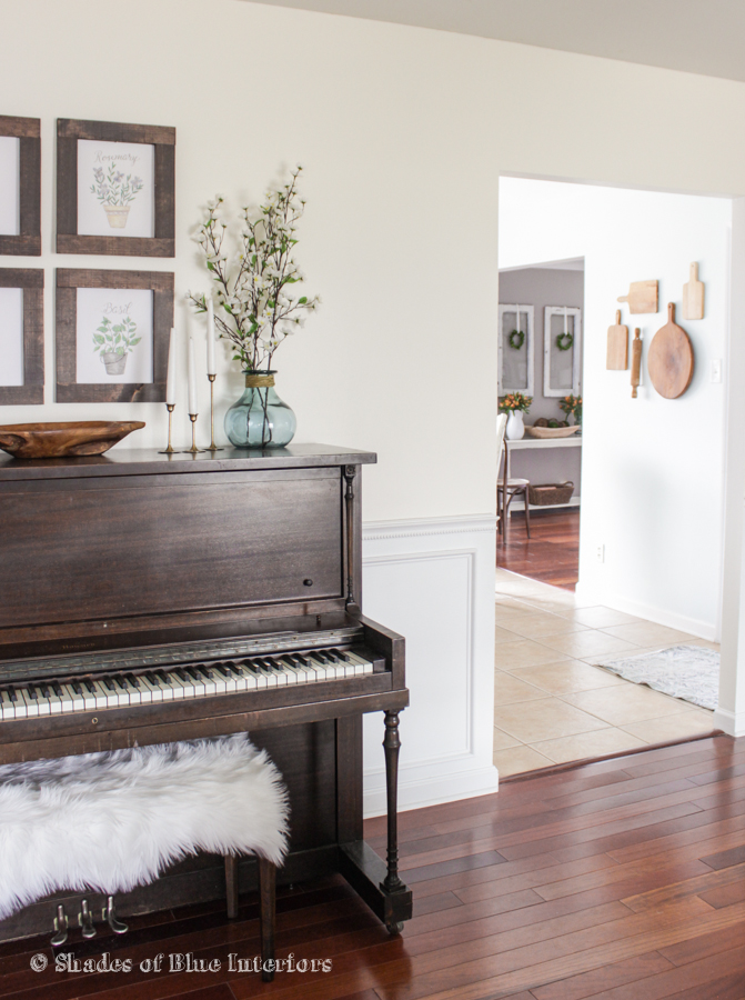 Love a piano in a home - and the cutting board collection hung on the wall kellyelko.com