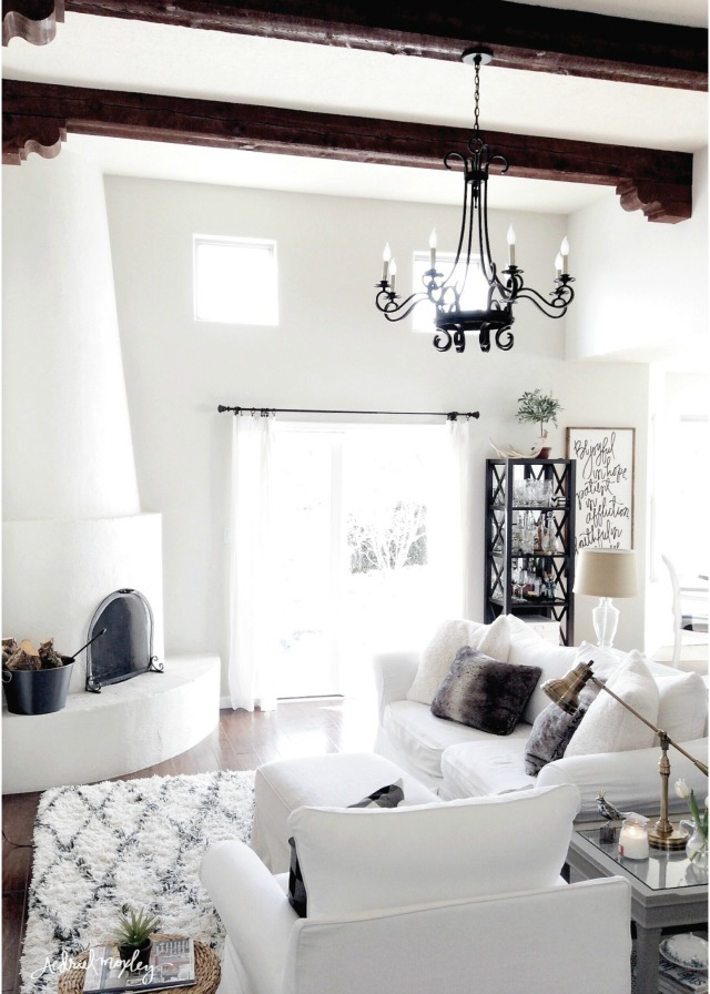 Eclectic Home Tour of Aedriel Moxley - love the architectural details like the wood beam ceiling and the adobe fireplace kellyelko.com