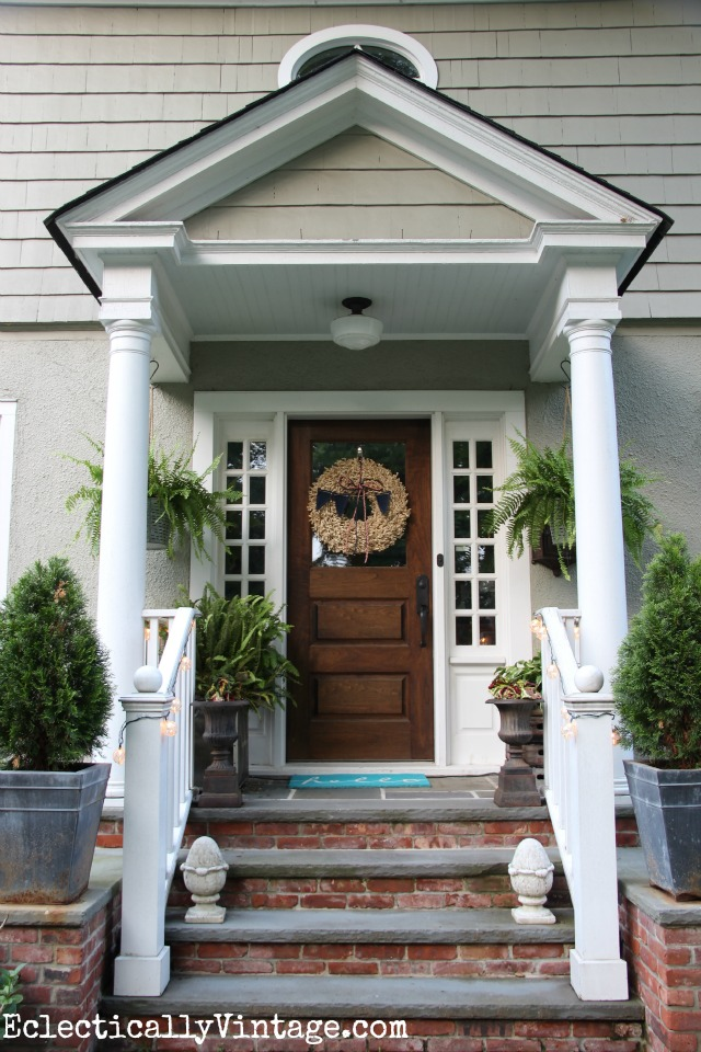 Love this front porch with brick and bluestone and tons of plants kellyelko.com