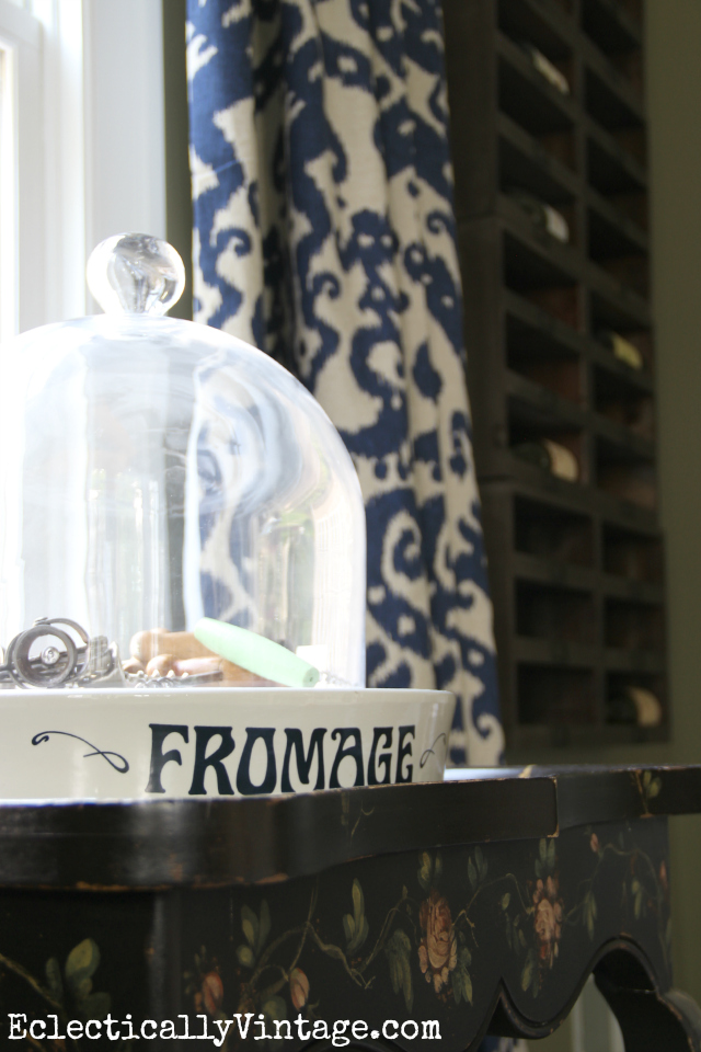 Love this vintage fromage cheese platter - she displays a collection of old corkscrews under the cloche kellyelko.com