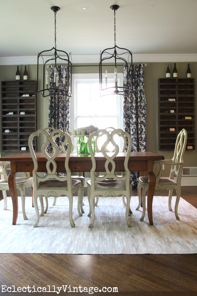 Dining Room Wine Cellar - Create a wine cellar in your dining room with these rustic wine cubbies! Love the way they fill up the walls and replace art kellyelko.com #winecellar #diningroomdecor #wine #diningroom #lighting #chandelier #rusticdecor #eclecticdecor