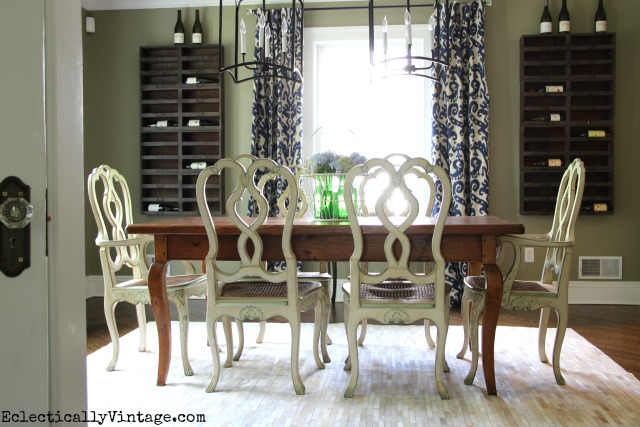 I love this dining room - the wine cubbies, the cowhide rug, the farm table ... kellyelko.com