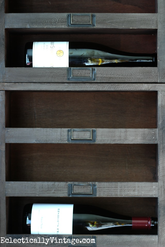 Love these wood wine cubbies and the vintage looking metal tags - display wine in style kellyelko.com