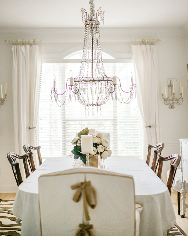 White dining room with glamorous crystal chandelier kellyelko.com