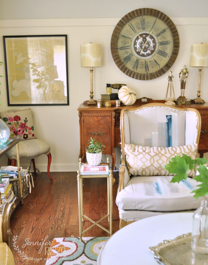 Bohemian vintage living room - love the hand painted chair!