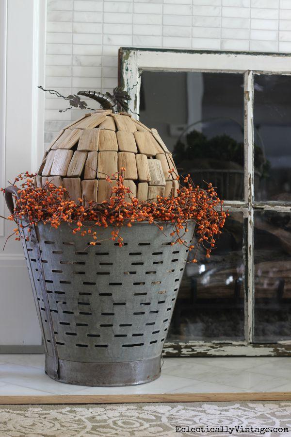 Love this driftwood pumpkin in an antique olive basket kellyelko.com