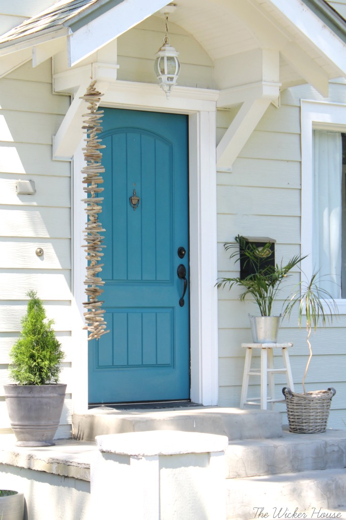 Love this blue front door - step inside to take the tour of this charming cottage of The Wicker House