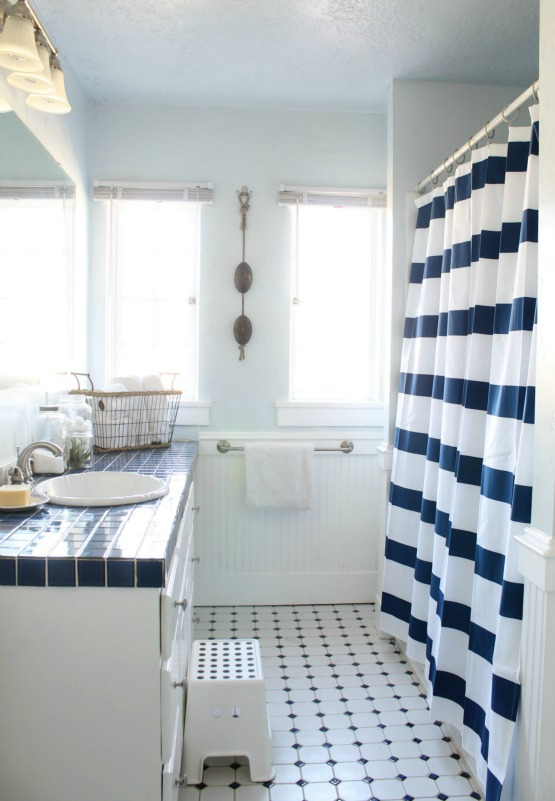Blue and white bathroom - love the striped shower curtain