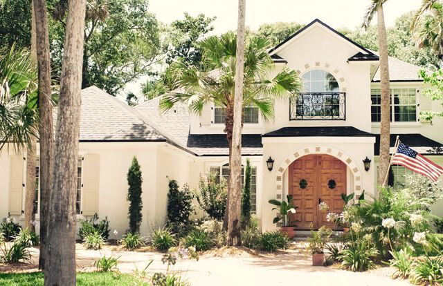 Spanish style house tour - love the double carved front doors kellyelko.com