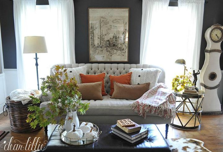 Beautiful fall living room - love the dark gray walls and neutral furniture with a pop of orange