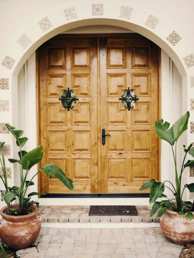 Love The Spanish Influence In This House Remodel And The Double Wood Carved  Front Doors With