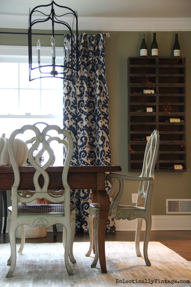 Love the wine cubbies in this eclectic dining room kellyelko.com