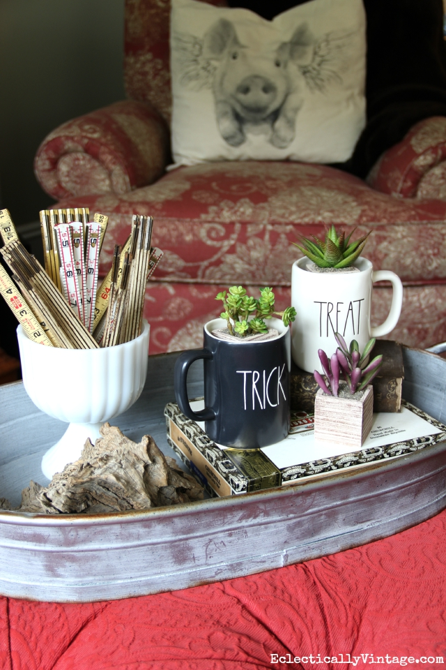 Fun fall coffee table display - love the Trick and Treat mugs filled with succulents kellyelko.com