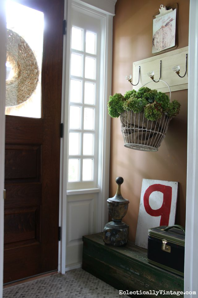 Entry with a welcoming basket of dried hydrangeas kellyelko.com
